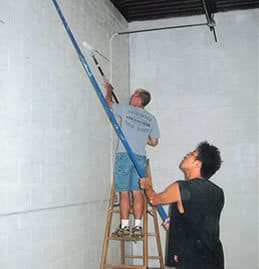 Volunteers painting the new Winona Volunteer Services building