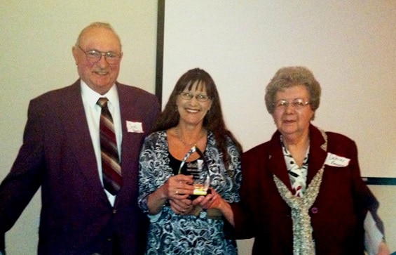 Susie Koehler is presented the 2014 award by Mr. and Mrs. Benusa, our 2013 award recipients.